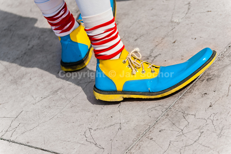 A clown wears oversized multi colored shoes during the Clown Congress in San Salvador, El Salvador, 18 May 2011. The clown performance is considered a regular job in most of Latin American countries. Clowns may work individually or in groups, often performing advertisement like acts in large open-to-street shops or they take part in private shows, like children birthdays, family events etc. There are many clown conventions all over Latin America where clowns gather and exchange their experiences offering workshops of the comic acting or the art of make-up. For some of them, being clown is a serious lifetime profession.