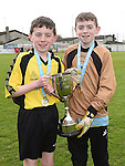 Drogheda Town's Robert and Hugh Murphy with the under 13 cup after their team beat Walshestown in the DDSL cup final in United Park. Photo:Colin Bell/pressphotos.ie