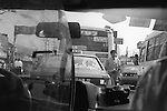 The Peoples Republic of China. Shanghai. A traffic-jam seen from inside a taxi. A short journey in Shanghai costs 10RMB. Taxi drivers can be both friendly and helpful. However it is unusual to find one who understands English so it is very useful to have written down in Chinese where you are going and your return address.  Maps in English and Chinese are also handy. FROM THE BOOK SHANGHAI ODYSSEY BY HOMER SYKES WITH THE SUPPORT OF THE GRIMSTONE FOUNDATION. PUBLISHED BY DEWI LEWIS PUBLISHING ISBN 1-89923514-0