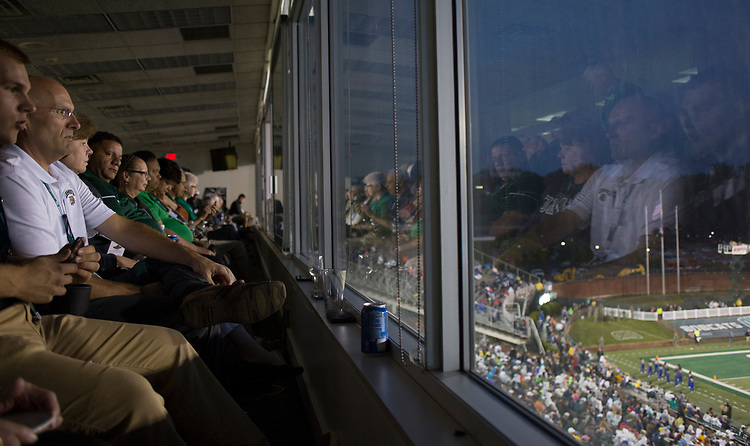 Guests watch the football game between the Ohio Bobcats and Hampton Pirates on Sept. 2, 2017 in the Presidents box at Peden Stadium.