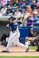 Jared Reaves (7) of the West Michigan Whitecaps follows through on his swing against the Quad Cities River Bandits at Fifth Third Ballpark on May 5, 2013 in Comstock Park, Michigan.  The River Bandits defeated the Whitecaps 5-4.  (Brian Westerholt/Four Seam Images)