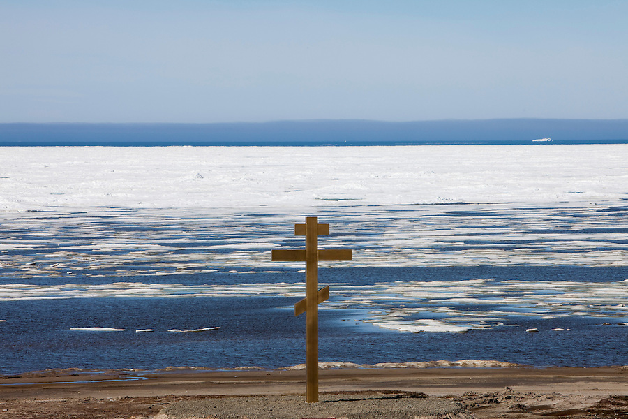 Kharsavey,Yamal Peninsula, Russia, 10/07/2010..A giant Russian Orthodox cross constructed by workers at the new port under construction at Kharsavey for the Gazprom Yamal Bovanenkovo gasfield project. The Kara Sea in July is frozen for a distance of 7 to 10 kilometres offshore.