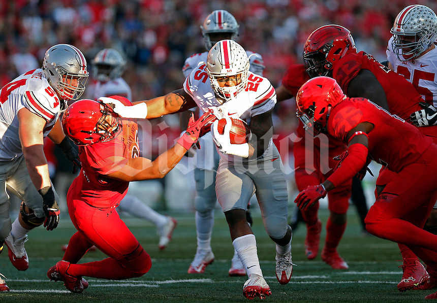 Ohio State Buckeyes running back Mike Weber (25) gets past Maryland Terrapins defensive back Alvin Hill (27) during the 1st half at Maryland Stadium in College Park, Md. on November 12, 2016.  (Kyle Robertson / The Columbus Dispatch)