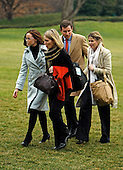 Washington, DC - January 10, 2009 -- (L-R) Barbara Bush, personal aid to the first lady Lindsey Knutson, Henry Hager and Jenna Bush walk across the South Lawn after arriving with U.S. President George W. Bush to the White House January 10, 2009 in Washington, DC. President Bush and his family returned from Norfolk, Virginia, where he commissioned the USS George H.W. Bush (CVN 77), the Navy aircraft carrier named for his father and former President George H.W. Bush.  .Credit: Chip Somodevilla - Pool via CNP