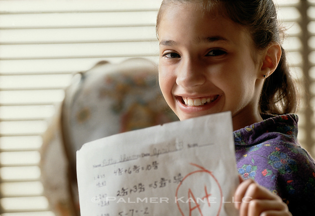 "girl shows ""A"" paper in math class"