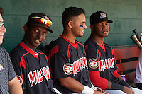 Batavia Muckdogs Galvi Moscat (27), Angel Reyes (30) and Isael Soto (21) in the dugout during a game against the Auburn Doubledays on September 7, 2015 at Falcon Park in Auburn, New York.  Auburn defeated Batavia 11-10 in ten innings.  (Mike Janes/Four Seam Images)