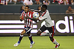 22 August 2009: Chivas USA's Maykel Galindo (CUB) (11) is defended by Toronto's Emmanuel Gomez (32). CD Chivas USA played Toronto FC at the Home Depot Center in Carson, California in a regular season Major League Soccer game.