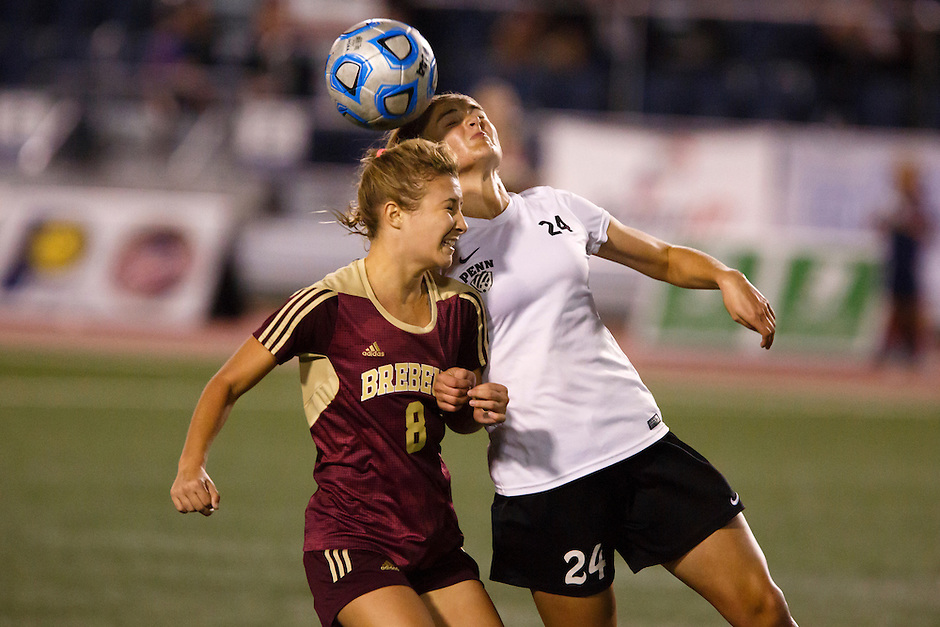 Penn's Kristina Lynch (24) heads the ball away from Brebeuf Jesuit's Natalie Kelley (8) during the IHSAA Class 2A Girls Soccer State Championship Game on Saturday, Oct. 29, 2016, at Carroll Stadium in Indianapolis. Special to the Tribune/JAMES BROSHER