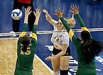 SIOUX FALLS, SD - DECEMBER 8:  Mallory Blauser #14 from Angelo State tries for a kill past Erin Braun #15 and Diana Fa'amausili #17 from Alaska Anchorage in the Women's Division II Volleyball Championship Thursday at the Sanford Pentagon in Sioux Falls, SD.  (Photo by Dave Eggen/Inertia)