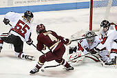 Tori Hickel (NU - 55), Melissa Bizzari (BC - 4), Chloe Desjardins (NU - 29), Maggie Brennolt (NU - 22) - The Northeastern University Huskies defeated Boston College Eagles 4-3 to repeat as Beanpot champions on Tuesday, February 12, 2013, at Matthews Arena in Boston, Massachusetts.