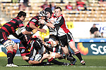 Luke Mealamu goes to ground in the tackle as the support in the form of Ross Kennedy & Nigel Watson arrive during the Ranfurly Shield challenge against Canterbury at Jade Stadium on the 10th of September 2006. Canterbury won 32 - 16.