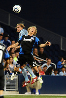 Steven Lennart (24) San Jose Earthquakes forward and Chance Myers Sporting KC defender go up for a header... Sporting KC defeated San Jose Earthquakes 1-0 at LIVESTRONG Sporting Park, Kansas City, Kansas.