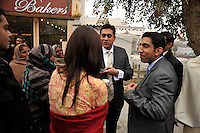 Beggars hang around outside as they try to get money from departing guests from the wedding ceremony of British/Punjabi couple Lindsay and Navneet Singh at a gurdwara in Amritsar.