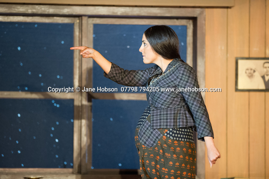 "London, UK. 30.09.2014. English National Opera's production of ""The Girl of the Golden West"", by Giacomo Puccini, directed by Richard Jones, conducted by Keri-Lynn Wilson, opens at London Coliseum. Picture shows: Clare Presland (Wowkle). Photograph © Jane Hobson."