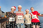 Mary O'Shea and Kieran O'Shea (Cahersiveen) with Angela Curran (Listry) and Frances Quinn (Killorglin), pictured at the Santa Fun Run, in aid of Barretstown, starting from the Tralee Bay Wetlands, on Sunday last.