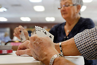 NWA Democrat-Gazette/DAVID GOTTSCHALK The cards of Dale Hutchinson are visible as his wife Emojene (cq) draws another card as they participate in a game of Tic Monday, February 4, 2019, at the Farmington Senior Activity and Wellness Center. The Tic card game is a multi-player game that requires two decks of cards.
