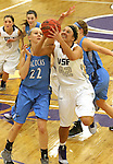 SIOUX FALLS, SD - DECEMBER 5:  Amber Paden #42 from the University of Sioux Falls takes the ball to the basket past Lauren Buck #22 from Upper Iowa in the second half of their game Friday night at the Stewart Center.  (Photo by Dave Eggen/inertia)