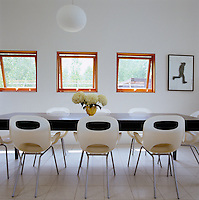 'Oh' dining chairs by Karim Rashid surround the long dining table designed by Peter Frank and Kathleen Triem