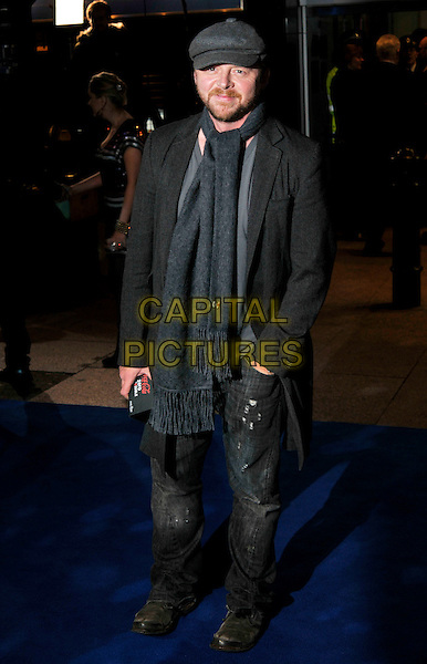 "SIMON PEGG .Arrivals - World Premiere of ""Avatar"",  Odeon Leicester Square, London, England, UK, December 10th, 2009..full length grey gray scarf flat cap hat coat jeans .CAP/PL.©Phil Loftus/Capital Pictures."