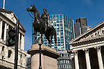 Bank of England City of London Skyline. Royal Exchange building Duke of Wellington Statue Royal Exchange Square. EC2. Green Go pedestrian traffic light airplane overhead.