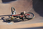 Accident and fallen bicycle at a skateboard park, Denver, Colorado. .  John offers private photo tours in Denver, Boulder and throughout Colorado. Year-round.