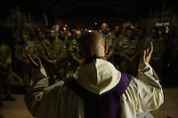Italian soldiers from the Fifth  Lancieri of Novara regiment of the Italian Cavalry attend a catholic mass conducted by DON MARCO at  the UNIFIL Chama base in Southern Lebanon on Saturday Dec 09 2006..Close to 1000 Italian peacekeepers operate in  the in Southern lebanon town of Chama, constantly patrolling their sector in search for illegal weapons in the country.