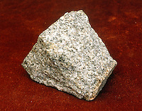 GRANITE<br /> An Igneous Rock<br /> Illustrates the typical occurrence of amphiboles in silicic plutonic rocks. The sample is composed of equal parts of quartz, plagioclase &amp; k-feldspar, with hornblende being the dominate dark mineral. Minor giotite is also present.