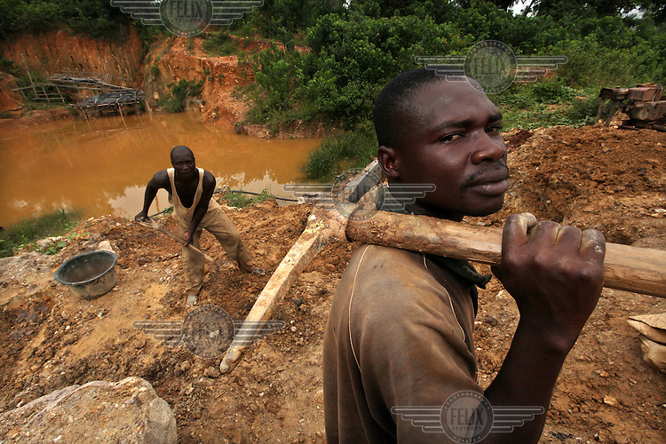 Kwame Andoh (right) works on a gold mining site in Obuasi. Many unemployed young people have taken to working as illegal artisanal gold miners known as galamseys in Ghana...