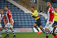 Tyler Roberts of Oxford United scores his goal during the The Checkatrade Trophy match between Oxford United and Exeter City at the Kassam Stadium, Oxford, England on 30 August 2016. Photo by Andy Rowland / PRiME Media Images.
