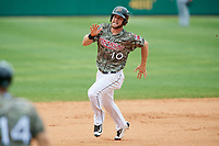 Arkansas Travelers first baseman Kyle Waldrop (10) runs the bases during a game against the Frisco RoughRiders on May 28, 2017 at Dickey-Stephens Park in Little Rock, Arkansas.  Arkansas defeated Frisco 17-3.  (Mike Janes/Four Seam Images)