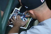 September 4, 2009:  Outfielder Brett Gardner of the Scranton Wilkes-Barre Yankees signs autographs during a rehab game at Frontier Field in Rochester, NY.  Scranton is the Triple-A International League affiliate of the New York Yankees and clinched the North Division Title with a victory over Rochester.  Photo By Mike Janes/Four Seam Images