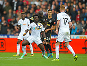 10th September 2017, Liberty Stadium, Swansea, Wales; EPL Premier League football, Swansea versus Newcastle United; Wilfried Bony of Swansea City controls the ball while under pressure from Mohamed Diame of Newcastle United