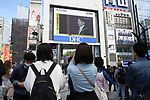 People watch a large screen showing Japan's new Emperor Naruhito attends the enthronement ceremony (First Audience after the Accession to the Throne) in Tokyo, Japan on May 1, 2019, the first day of the Reiwa Era. (Photo by YUTAKA/AFLO)