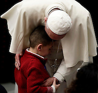 Pope Francis hugs a child at the end of  his weekly general audience in Paul VI hall at the Vatican on November 30, 2016. UPDATE IMAGES PRESS/Isabella Bonotto<br /> <br /> STRICTLY ONLY FOR EDITORIAL USE