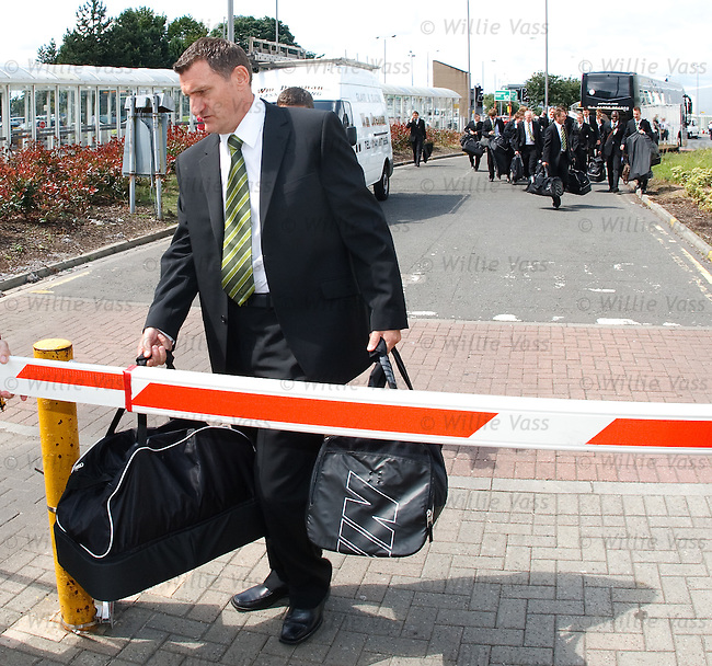 Celtic manager Tony Mowbray tries to lead his squad into Glasgow Airport but finds his way blocked by a barrier