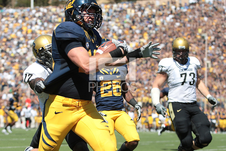 Colorado wide receiver Tony Clemons makes a last ditch effort to try to stop California line backer Mike Mohammed who scores the touchdown after his interception.  The California Golden Bears defeated the Colorado Buffaloes 52-7 at Memorial Stadium in Berkeley, California on September 11th, 2010.
