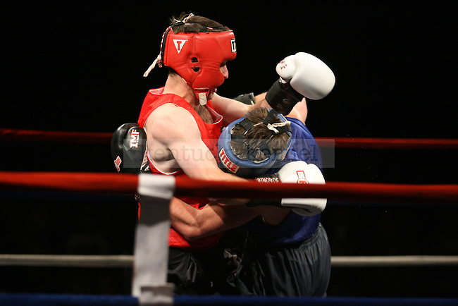 Delta Tau Delta's Brian Bodziony fights Delta Sigma Phi's Austin Skaggs during the Main Event hosted by Alpha Delta Pi sorority and Sigma Chi fraternity at the Lexington Convention Center on Friday, November 21, 2014. Photo by Taylor Pence | Staff