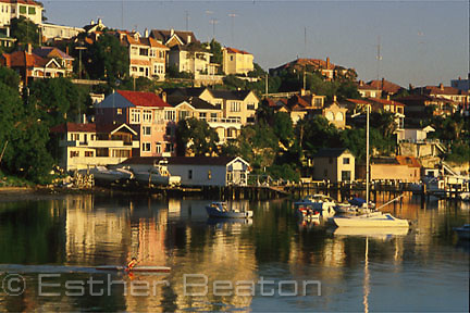 Point Piper, an exclusive suburb ovelooking Rose Bay, with canoist at dawn. Sydney, NSW