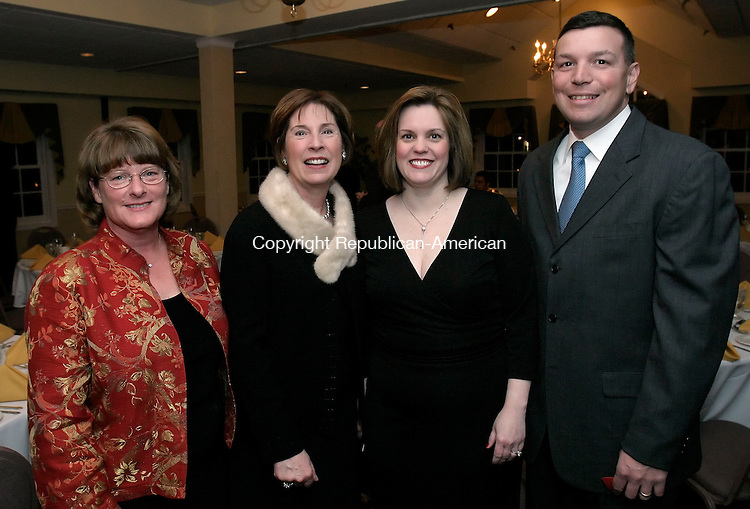 WATERTOWN, CT. 25 FEBRUARY 2006- 022506BZ10- From left- Janet Dunbar, of Watertown, v.p. of the Board of Directors for the Watertown Public School Education Foundation; Susan Atkins, of Watertown, president of the Board of Directors for the Watertown Public School Education Foundation; Susan Santopietro, treasurer of the Board of Directors for the Watertown Public School Education Foundation; and John Santopietro;<br /> <br /> at a dinner dance fundraiser for the Watertown Public School Education Foundation Saturday night.  <br /> Jamison C. Bazinet / Republican-American