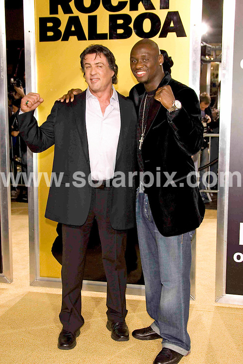 ALL ROUND PICTURES FROM SOLARPIX.COM SYNDICATION RIGHTS FOR UK, SOUTH AFRICA, DUBAI, AUSTRALIA..Sly Stallone and Antonio Tarver arrive at the premiere of the film, ROCKY BALBOA in Hollywood, Ca. at Grauman's Chinese Theater on Dec 13, 2006...DATE: 13/12/2006-JOB REF: 3164-PHZ.**MUST CREDIT SOLARPIX.COM OR DOUBLE FEE WILL BE CHARGED**