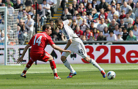 Barclay Premier League, Swansea City (white) V Liverpool (red) Liberty Stadium, 13/05/12<br /> Pictured: Jordan Henderson (left) and Gylfi Sigurdson watch the ball<br /> Picture by: Ben Wyeth / Athena <br /> info@athena-pictures.com