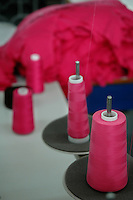 Thread rollers at a garment stitching factory in Tirupur, Tamilnadu. After lifting of quota system in textile export on 1st january 2005. Tirupur has become the biggest foreign currency earning town of India.