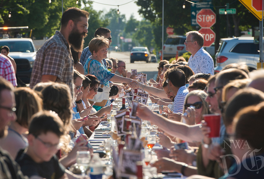 NWA Democrat-Gazette/CHARLIE KAIJO Guests greet each other before a dinner, Saturday, June 9, 2018 on Emma Ave. in Springdale. <br />