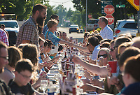 NWA Democrat-Gazette/CHARLIE KAIJO Guests greet each other before a dinner, Saturday, June 9, 2018 on Emma Ave. in Springdale. <br /><br />Back for its 3rd year, this popular event brought hundreds of guests together for a lively, friendly community dinner of multiple courses served under the night sky&acirc;&euro;&rdquo;right down the middle of Emma Avenue. Past attendees raved about the special experience of dining al fresco with family and friends, as well as meeting new neighbors.