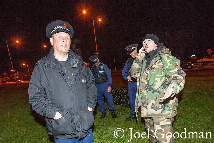 "© Joel Goodman - 07973 332324 . 03/03/2012 . Heywood , UK . North West Infidels leader JOHN SHAW (aka Snowy ) (r) at the protest . Following a National Front demonstration in nearby Heywood, a rooftop demonstration by the ""North West Infidels"" and the ""Combined Ex Forces"" is held on Bury Town Hall. Police said the group had climbed up scaffolding at the side of the Town Hall building to gain roof access. Protesters have affixed banners stating ""Hang paedo scum"" and various nationalist slogans . Photo credit : Joel Goodman"