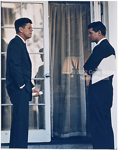 Washington, DC - U. S. President John F. Kennedy and U.S. Attorney General Robert F. Kennedy in the Oval Office doorway on March 28, 1963. .Mandatory Credit: Robert Knudsen - The White House via CNP