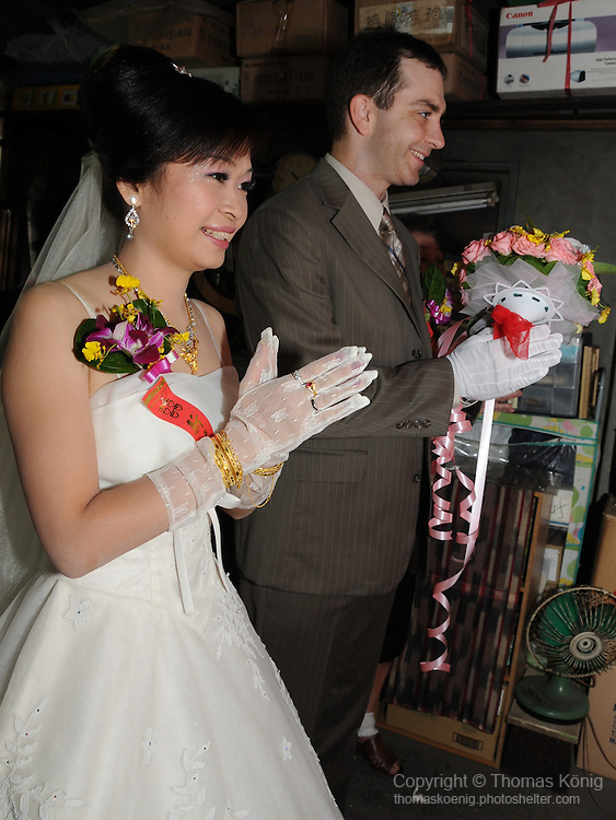 Taiwanese Wedding -- Praying in front of the traditional family shrine at the bride's home.