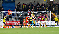 5th January 2020; Pirelli Stadium, Burton Upon Trent, Staffordshire, England; English FA Cup Football, Burton Albion versus Northampton Town; Scott Wharton of Northampton Town gets above Jake Buxton of Burton Albion to head the ball clear of the goal - Strictly Editorial Use Only. No use with unauthorized audio, video, data, fixture lists, club/league logos or 'live' services. Online in-match use limited to 120 images, no video emulation. No use in betting, games or single club/league/player publications