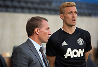 Brendan Rodgers (L) during the Swansea City Legends v Manchester United Legends at the Liberty Stadium, Swansea, Wales, UK