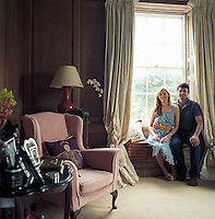 Actor Dominic Rowan and his wife Francesca on the window seat in the oak-panelled King's Room
